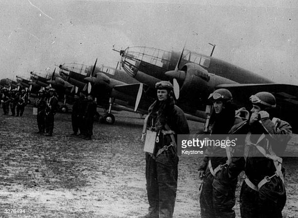 Crews line up in front of their planes for the start of the Polish Air Force Manoeuvres near the German Frontier