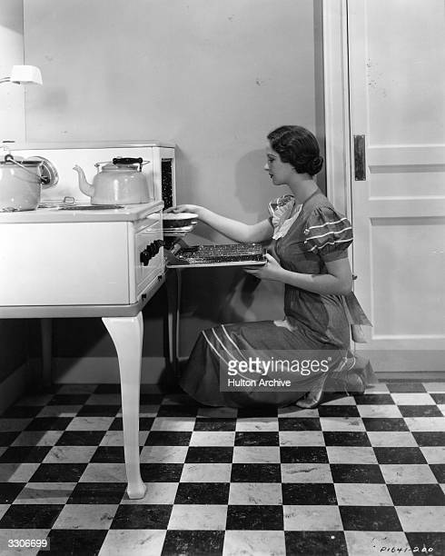 Evelyn Venable the American leading lady who was the original model of a woman holding a lamp on the Columbia Pictures 'logo'. She is viewed baking...