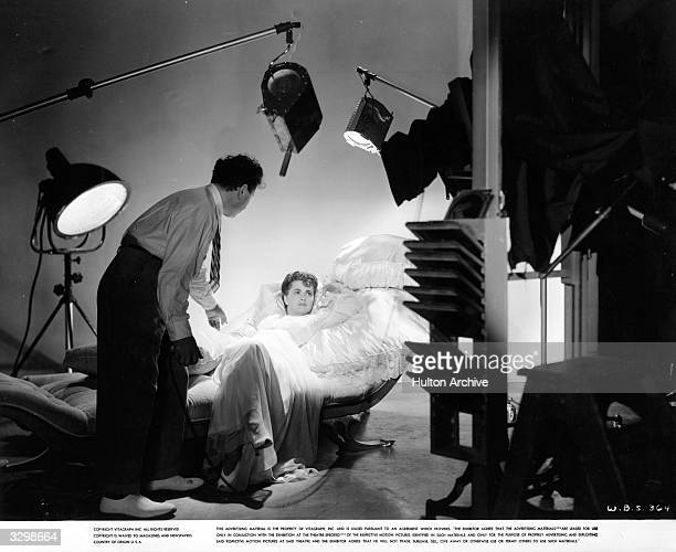 George Hurrell studio publicist poses Olivia de Havilland for some publicity shots