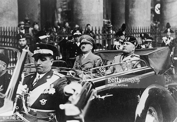 German Fuhrer Adolf Hitler rides in an open car with Italian dictator Benito Mussolini during a visit to Italy