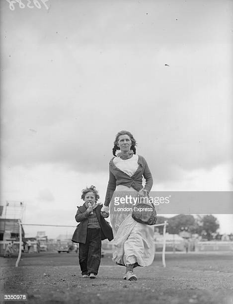 Gypsies Mary Lee and her son Freddie on the Epsom Downs during Derby week where they beg for money.