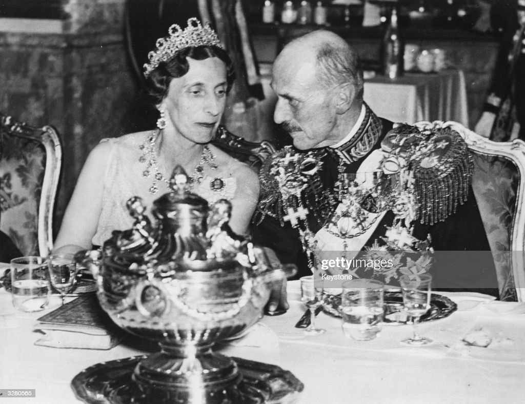 Haakon VII (1872 - 1957), King of Norway from 1905, son of Frederik VIII. Succeeded by his son Olav V. Seen here with Queen Louise of Sweden during the 80th birthday celebrations of King Gustav of Sweden in Stockholm.