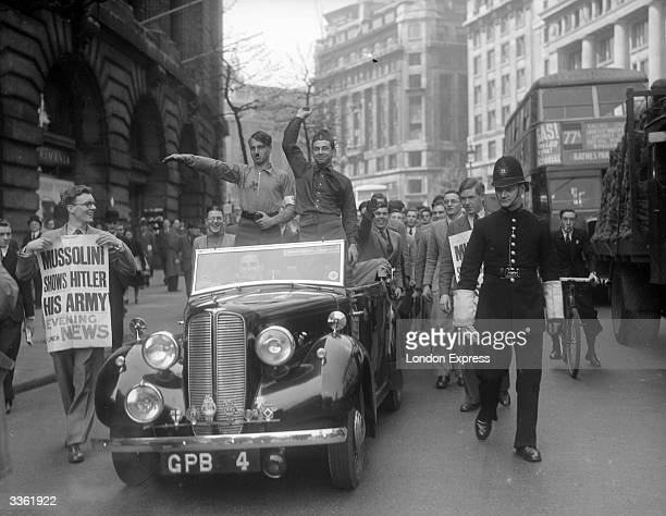 Students on the Humanity Parade pass along the Aldwych in London, led by a car containing a character dressed as Adolf Hitler, giving a Nazi salute.