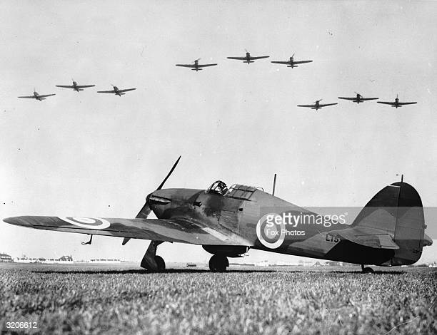 The RAF's new low wing fighter aircraft on show at an airfield while others fly past