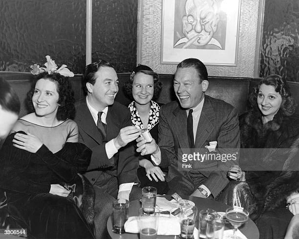 Visitors to the famous Sardi's Cafe include Gracie Allen the comedienne Jack Haley Fred Allen the radio comedian and Mary Livingston