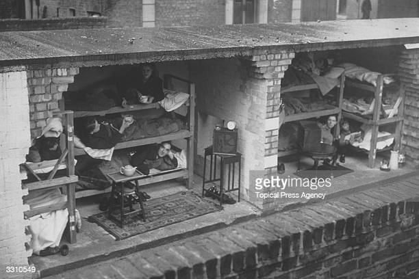 A section through a street airraid shelter showing how families were accommodated