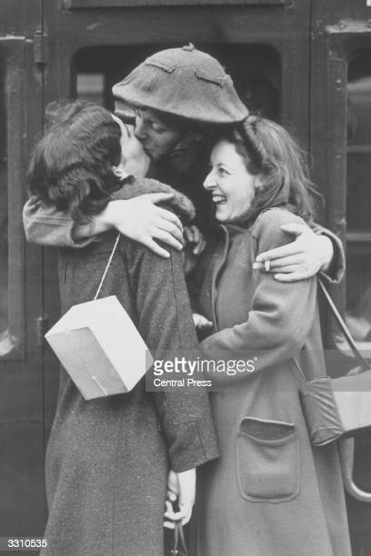 Soldier saying goodbye to two girlfriends before leaving for France from a station 'somewhere in England'.