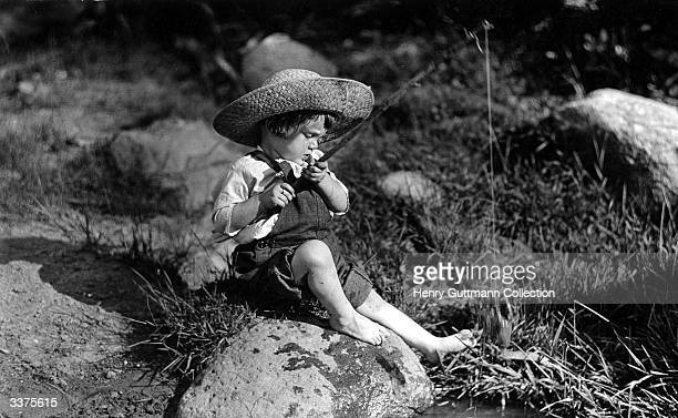 A young boy fishing