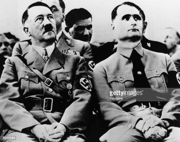 Adolf Hitler with his deputy and private secretary Rudolf Hess at a Nazi Party meeting