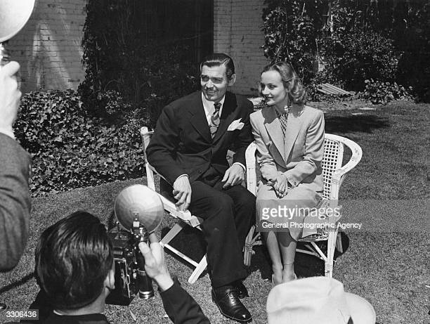 American film star Clark Gable being interviewed with his third wife Carole Lombard just after their marriage Gable is most famous for his portrayal...