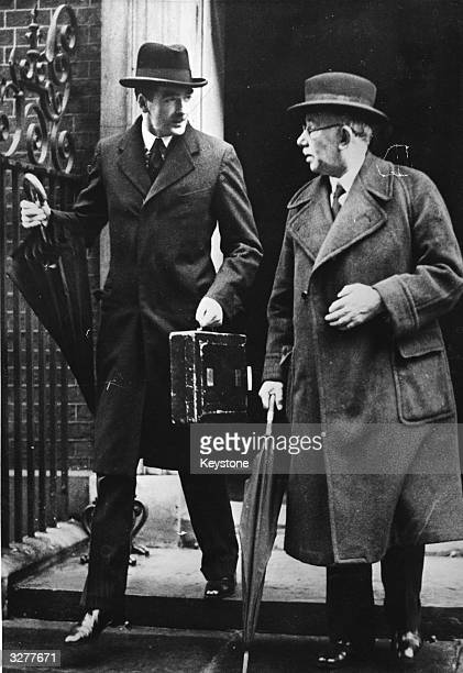 Anthony Eden to the left of J H Thomas leaving the Foreign Office in London