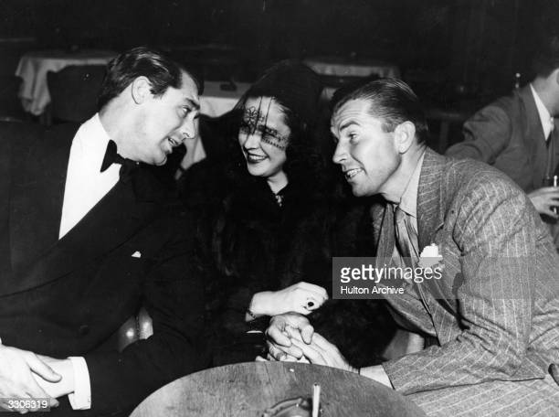 Cary Grant the stage name of Archibald Leach the English born Hollywood star and film actor who became an American citizen in 1942 His debonair...