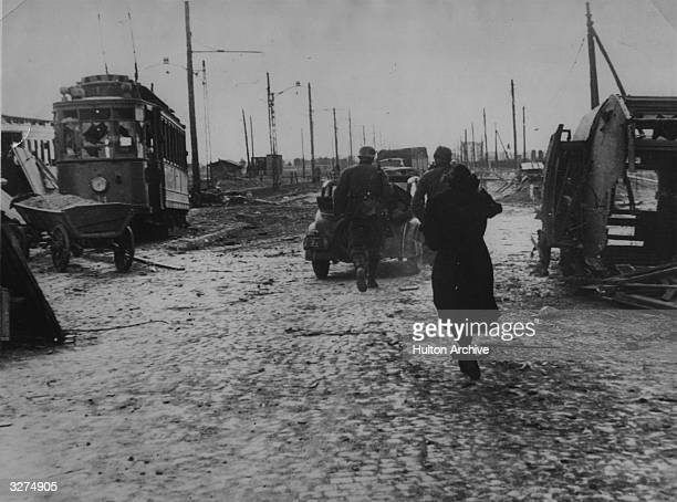 Citizens of Warsaw in the bomb damaged streets