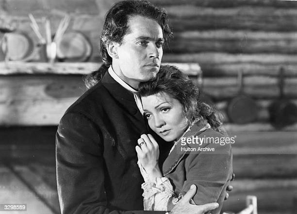 Claudette Colbert with Henry Fonda in a scene from 'Drums Along The Mohawk'. Title: Drums Along The Mohawk Studio: TCF Director: John Ford