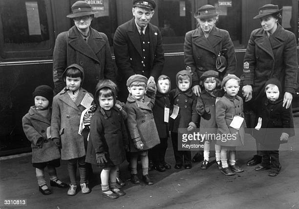 Evacuee children pictured here at the station preparing to leave London for the safety of the countryside
