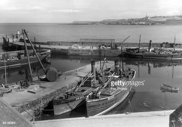 Fishing boats in the harbour at Banff, Aberdeenshire. Banff is a seaport and holiday resort at the mouth of the River Deveron. The town's main...