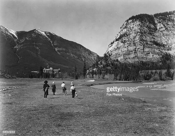 Golfers on the 14th Green of the Banff Springs golf course