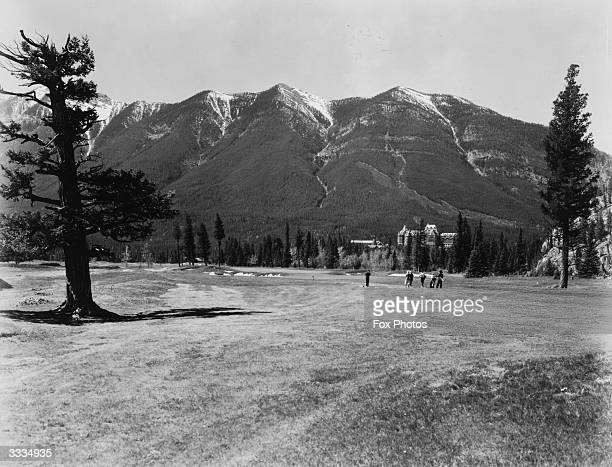 Golfers on the 15th Green of the Banff Springs golf course