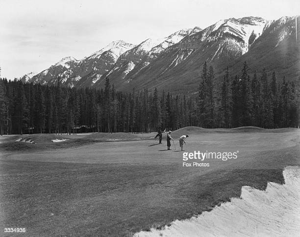 Golfers on the 17th Green of the Banff Springs golf course