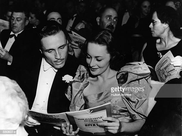 Hollywood screen star Olivia De Havilland at the opera with American actor Billy Bakewell