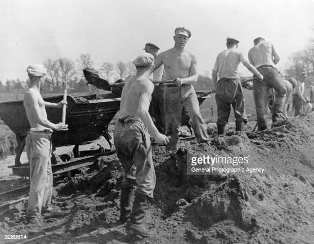 Men from a German labour camp the Third Reich's equivalent of the American CCC on a public works job