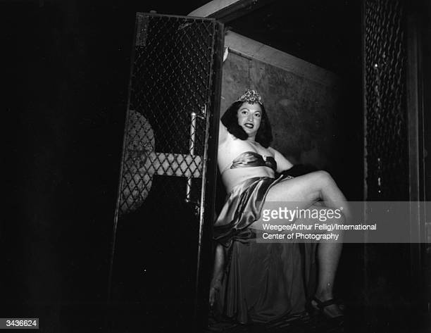 **NOT TO BE USED FOR POSTCARDS** A crossdresser is taken away in a police van for dressing like a girl Photo by Weegee/International Center of...