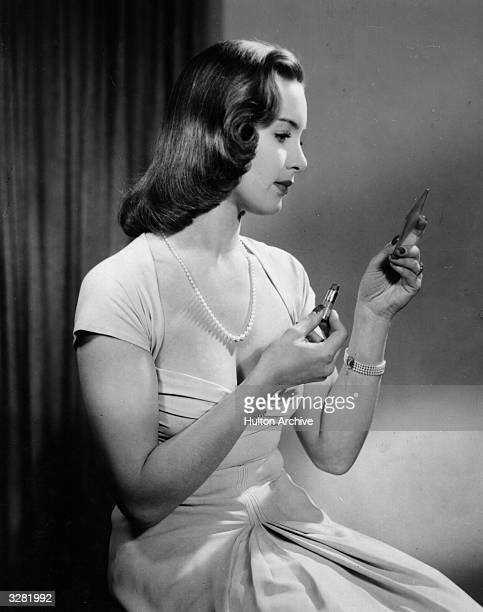 Patricia Roc the stage name of Felicia Riese the British leading lady of the 40's with some stage experience She is applying lipstick and looking in...