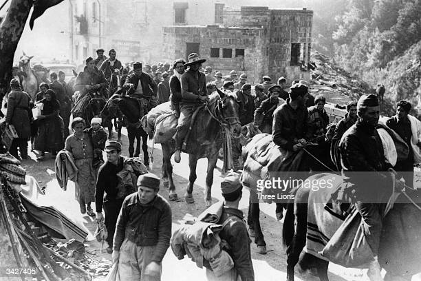 Refugees crossing the border at Le Perthus in the Pyrenees into France during the Spanish Civil War