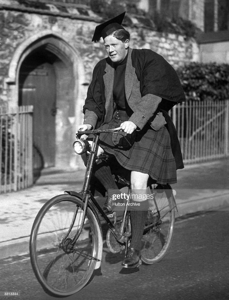 Scottish undergraduate A I Bell, cycling in Oxford.