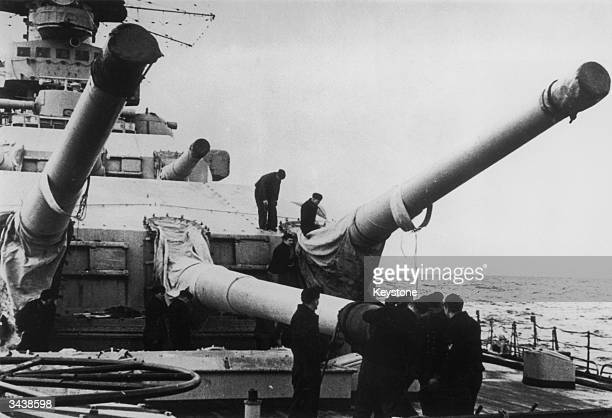 The large calibre guns of the German battleship Scharnhorst being prepared for use. She was sunk by the British navy off Norway in December 1943, in...