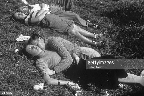 Two couples sleeping in the sun on the Isle of Wight.
