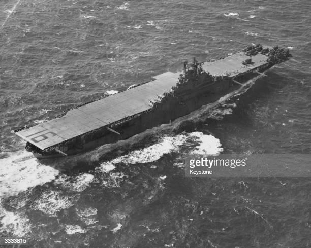 A birdseye view of the flight deck of American aircraft carrier USS Lexington