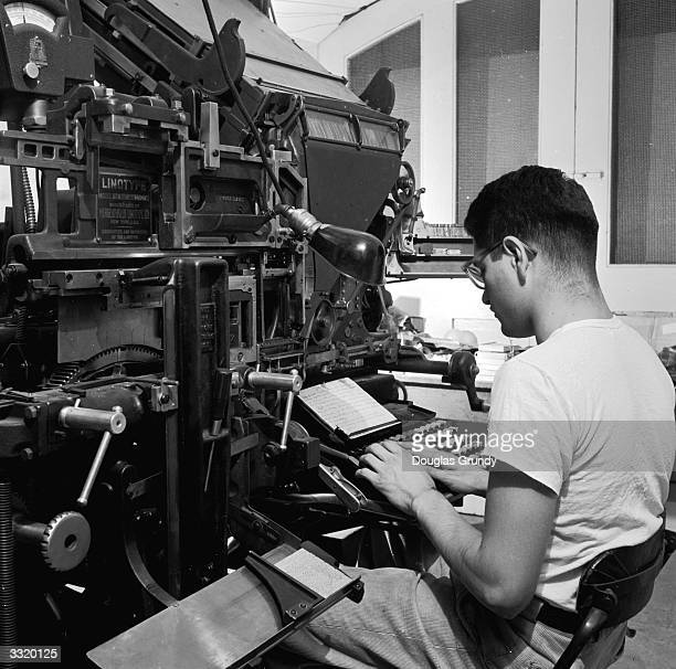 A deat student working on a linotype machine as part of his publishing and journalism course at Gallaudet college