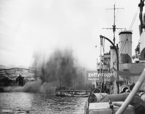 A German bomb exploding ahead of HMS Ardent at Harstad during Second World War naval and aerial action off the Norwegian coast