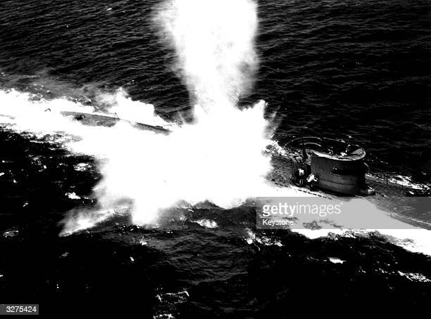 A German submarine receiving a direct hit from an American Naval Torpedo Bomber
