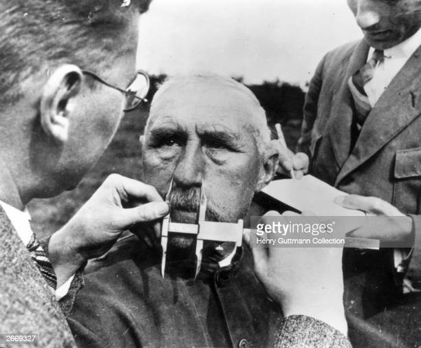 A man having his nose measured during Aryan race determination tests