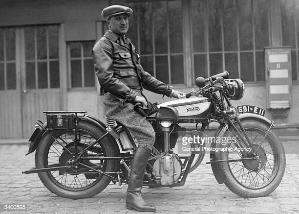 Man on a Norton motorcycle.