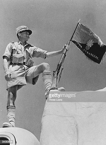 A soldier of the French Foreign Legion holding his regiment's banner at Bar Hacheim in Libya