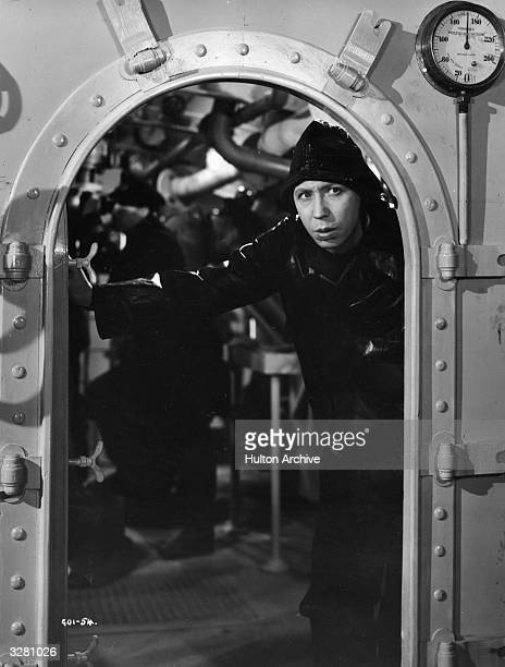 A sou'wester clad George Formby peers out of an engine room in a film which also stars Phyllis Calvert Garry Marsh Romney Brent Bernard Lee Coral...