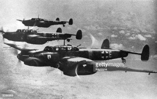 Squadron of German Messerschmitt 110 flighter-bombers flies in formation.