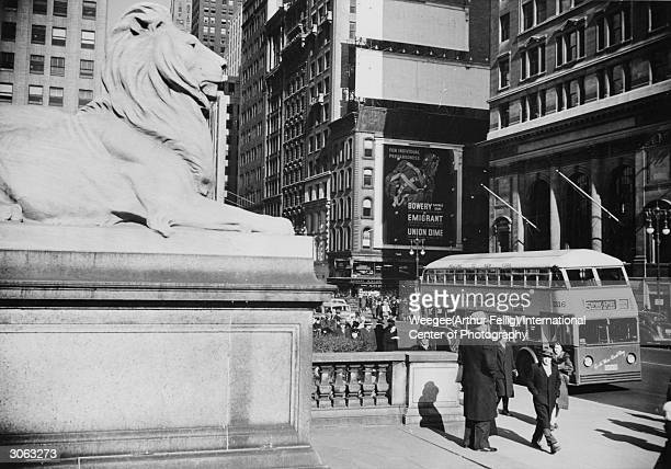 A stone lion guards the step of the New York Public Library Photo by Weegee/International Center of Photography/Getty Images