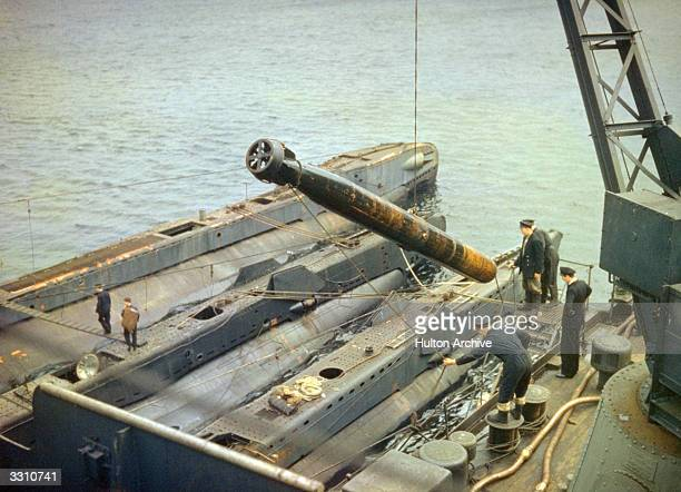 A torpedo being loaded onto a submarine