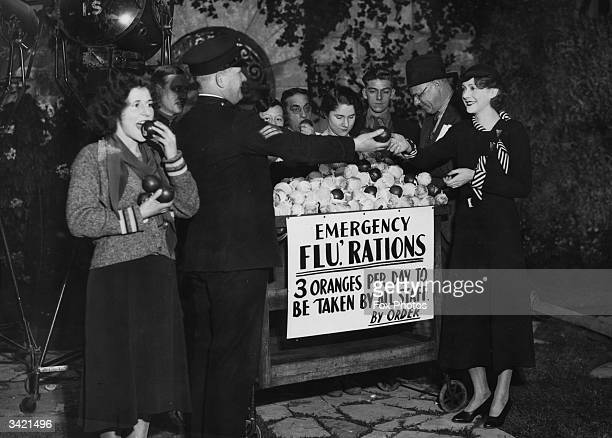Actress Molly Lamont receiving her orange 'rations' from a sergeant at Elstree Studios London It is being advised that everyone eat three oranges a...