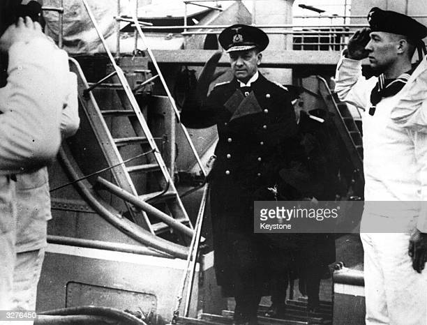 Admiral Erich Raeder the Commander in Chief of the German navy boarding a ship after reports that he had handed in his resignation to Hitler