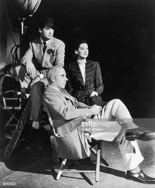 American film director Howard Hawks poses with Britishborn actor Cary Grant and American actor Rosalind Russell on the set of Hawks' film 'His Girl...