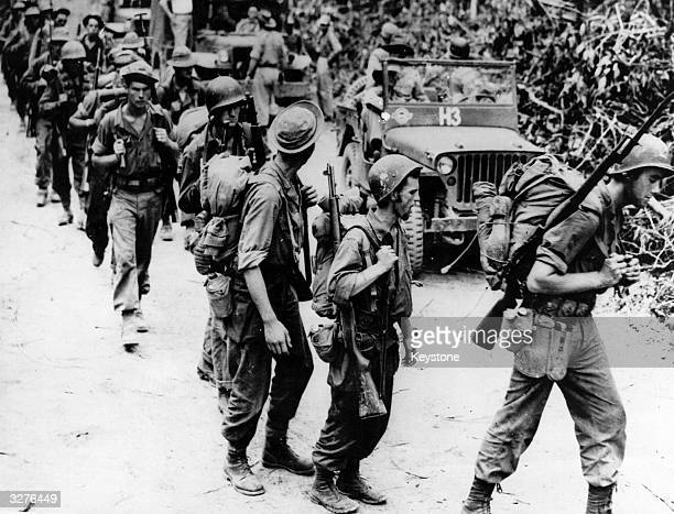 American soldiers members of General Frank Merrills 'marauders' with trained Chinese soldiers on a jungle trail in Burma