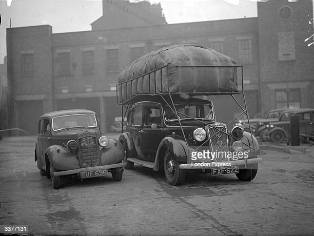 An Austin Therm balloon car The bag on the roof is full of coal gas used to fuel the saloon car thus saving petrol during World War II Gas made from...
