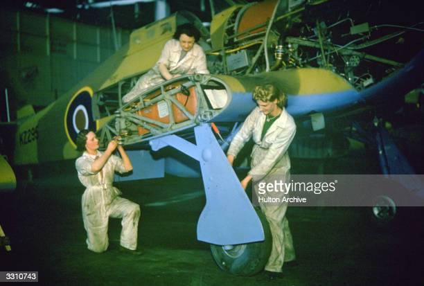 ATS engineers mending a Hawker Hurricane aircraft