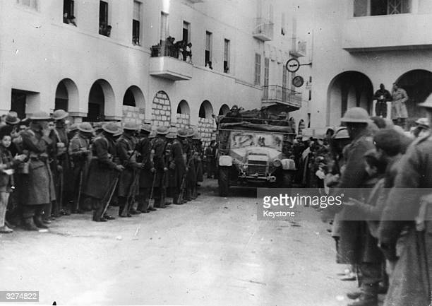 Australian troops entering Benghazi with the infantry lining the streets during the occupation of the Libyan town