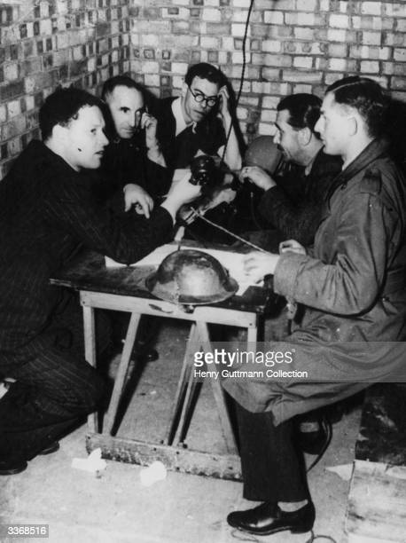 BBC men making a radio broadcast during a Second World War air raid at night